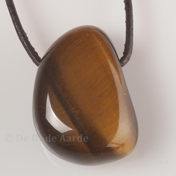 tijgeroog-doorboorde-steen